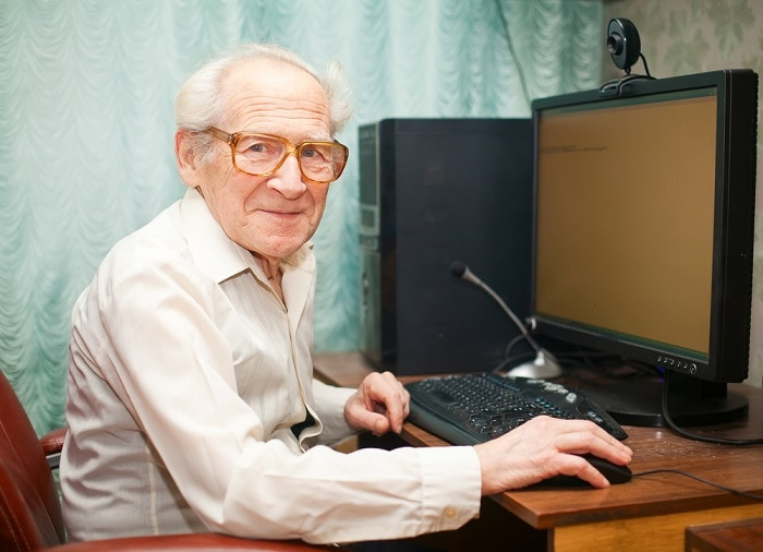 elderly man with computer searching for home care services