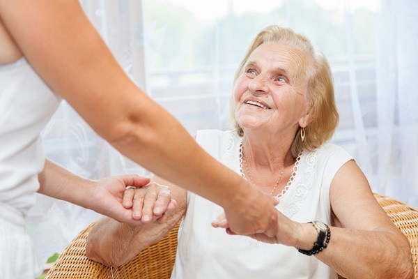 Elderly woman receiving non-medical in-home care service